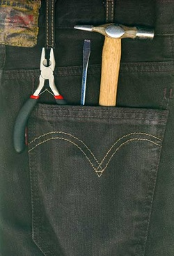 Tools in the back pocket of a pair of jeans